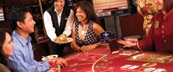 People Sitting at a Table Game