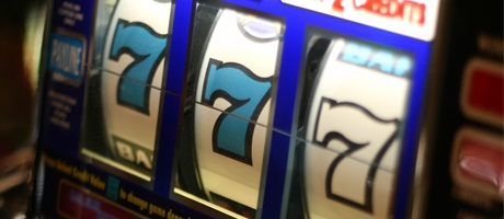 Two blue 7s and one white 7 on a classic reel slot machine