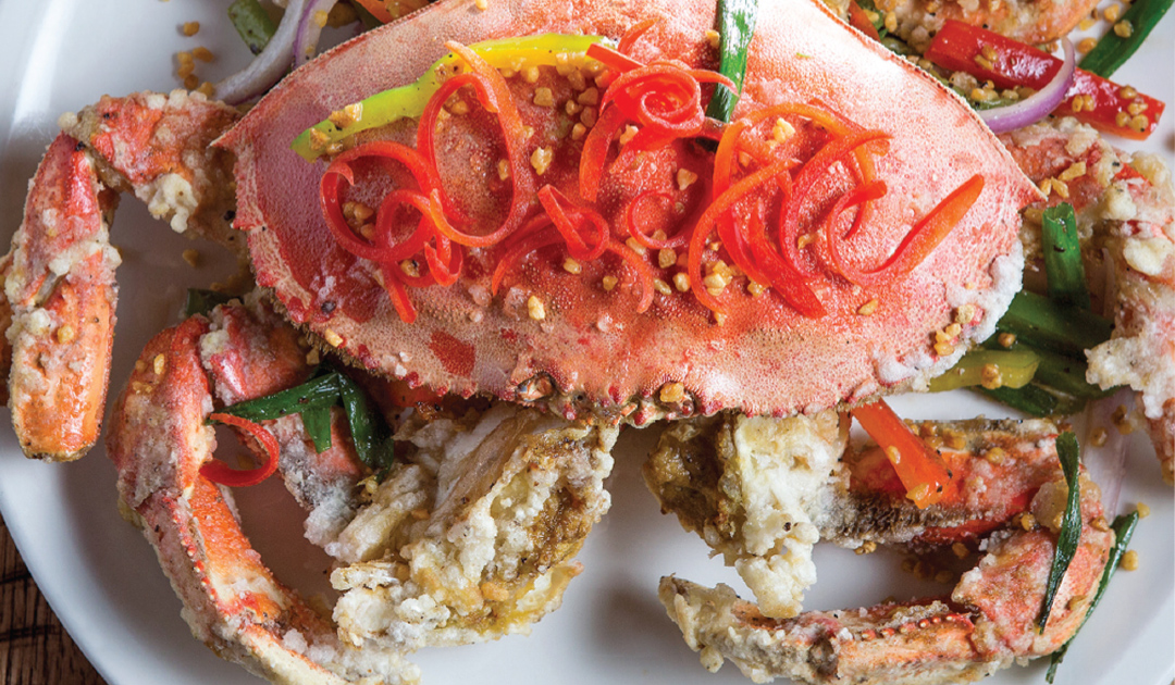 Whole crab on plate with garnish