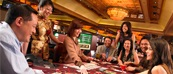 Several People playing Pai Gow Poker
