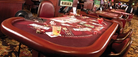 Table game table with drinks, chips, and cards